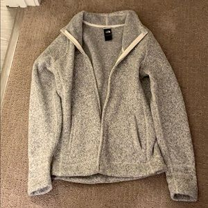 Never worn! The North Face grey and white zip up